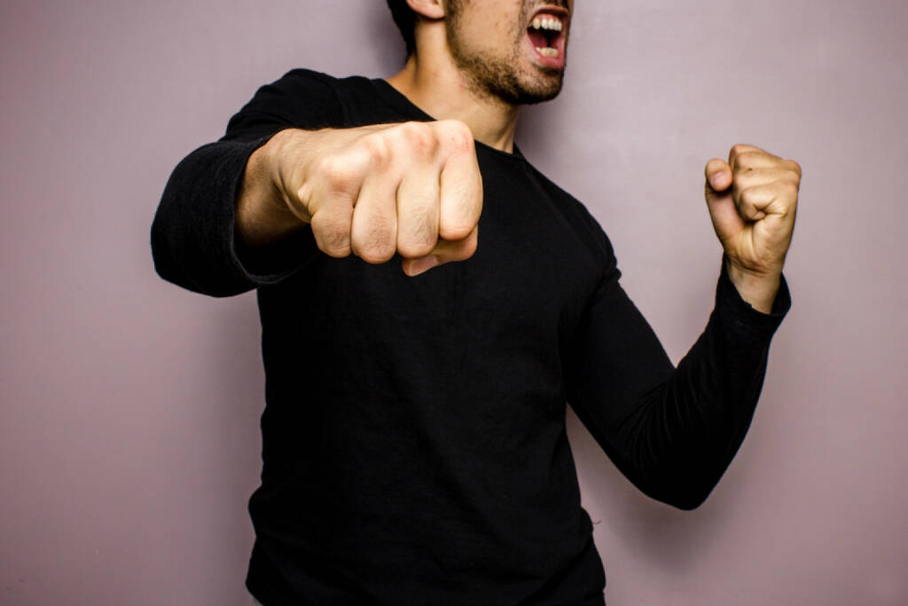 Aggression, Kampfgeist, Wut, Faust, geballte Faust, Schlag, http://www.shutterstock.com/de/pic-151024484/stock-photo-angry-man-throwing-a-punch.html , © (www.shutterstock.com) (01.07.2014)