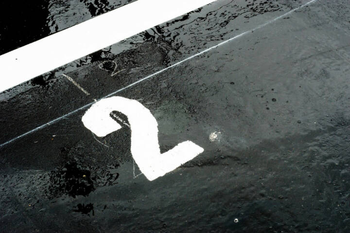 2, Zwei, http://www.shutterstock.com/de/pic-142824058/stock-photo-the-number-printed-on-the-wet-road-closeup.html