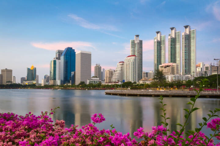 Bankok, Thailand, http://www.shutterstock.com/de/pic-194100380/stock-photo-bangkok-city-at-sunset-with-reflection-in-lake-and-flowers-on-the-foreground-bangkok-thailand.html