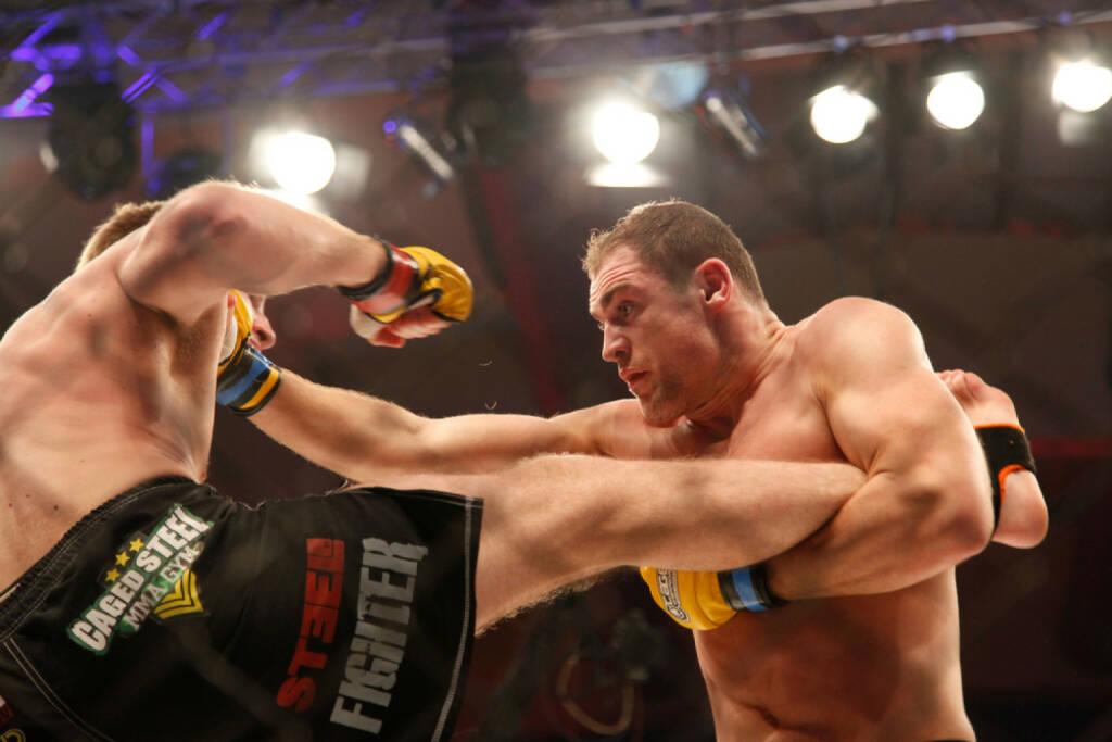 Wettkampf, Boxkampf, Cage Fight, Kampf, <a href=http://www.shutterstock.com/gallery-755863p1.html?cr=00&pl=edit-00>Ehab Othman</a> / <a href=http://www.shutterstock.com/?cr=00&pl=edit-00>Shutterstock.com</a> , Ehab Othman / Shutterstock.com, © www.shutterstock.com (08.07.2014)