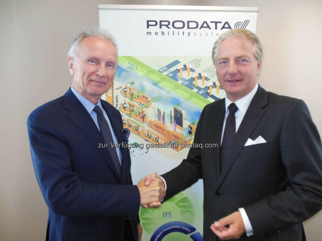 Kapsch AG: Kapsch CarrierCom erwirbt Prodata Mobility Systems NV - Franky Carbonez (Vorstandsvorsitzender von Prodata Mobility Systems NV) und Kari Kapsch (CEO von Kapsch CarrierCom) (c) Kapsch (17.07.2014)