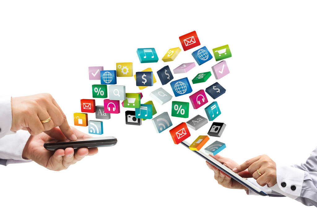 Smartphone, Tablet, Apps, Icons, http://www.shutterstock.com/de/pic-115239742/stock-photo-colorful-application-icons-with-hand-holding-the-phone-and-tablet-pc-isolated-on-white-background.html (18.07.2014)