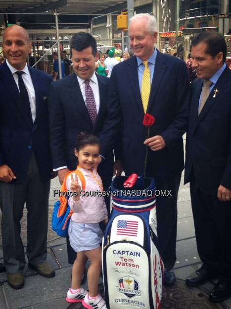 A young fan of the game presents PGA of America leadership with a rose following the #NASDAQ opening bell in Times Square #SheKnowsShesFly #FutureLPGAStar  Source: http://facebook.com/NASDAQ (03.09.2014)