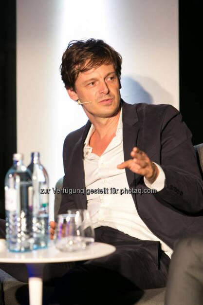Robert Treichler, Leiter Auslandsressort profil, http://blog.immofinanz.com/de/2014/10/15/talk-im-tower-afrika-fass-ohne-boden-oder-entwicklungsraum-mit-potenzial-/, © Martina Draper für Immofinanz (14.10.2014)