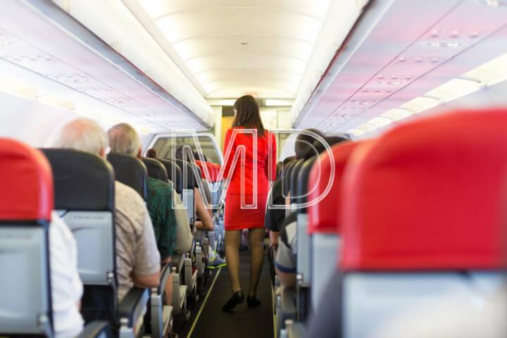 Flugzeug, fliegen, Kabine, Flugzeugkabine, Stewardess, Flugbegleiter, Service, Board, Bedienung, http://www.shutterstock.com/de/pic-180805772/stock-photo-interior-of-airplane-with-passengers-on-seats-and-stewardess-walking-the-aisle.html
