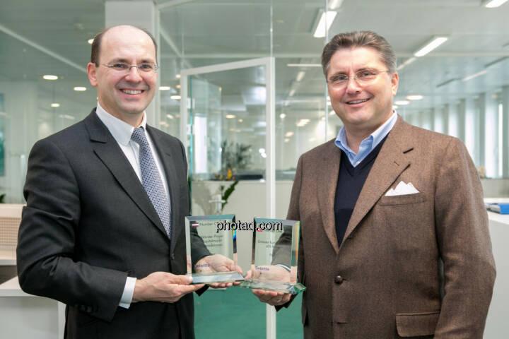 Christian Maier und Karl-Heinz Strauss: Number One Award für die Porr AG, den aktivsten Player, ATX-Prime-Topperformer, definitiv der Aufsteiger des Jahres 2014, was die Kapitalmarktpräsenz betrifft.