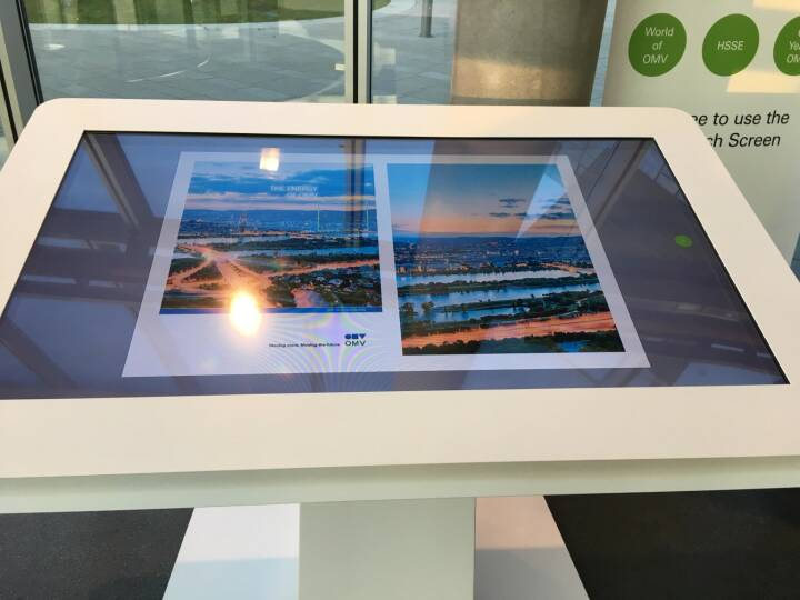 Bernhard Heneis OMV - Waiting at the OMV headquarters can be interesting . Just flip through the Annual Report at the mega multi touch board.